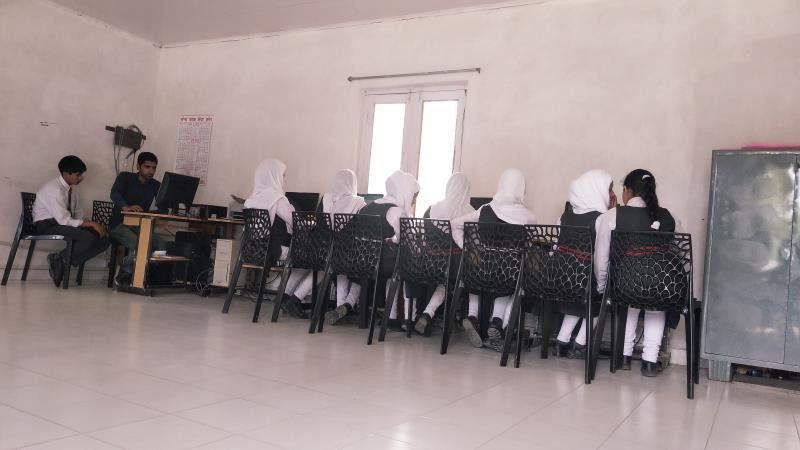 Class 6th Students Doing their Computer Practicals