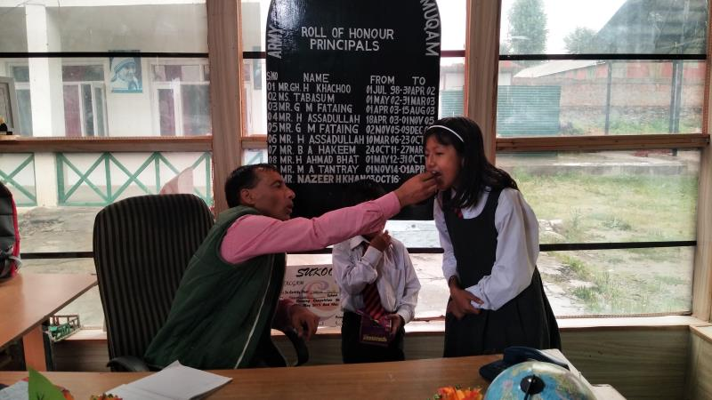 Sharing of Cake on The birthday of a Class 5th Student